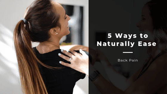 Woman getting a massage with the words saying, 5 ways to naturally ease back pain