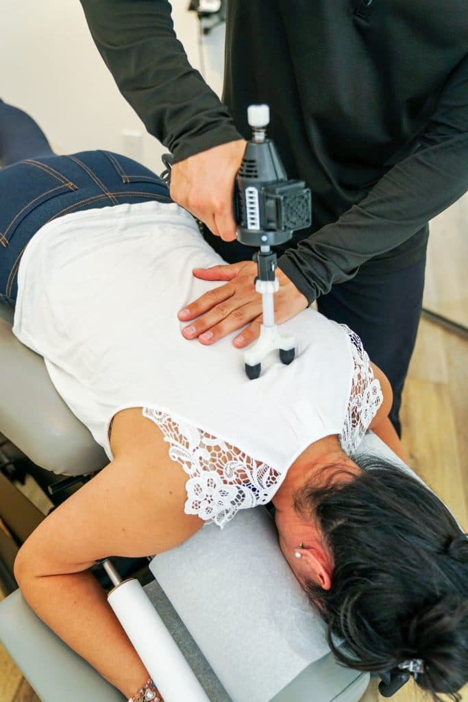 Patient laying down face first getting a chiropractic adustment