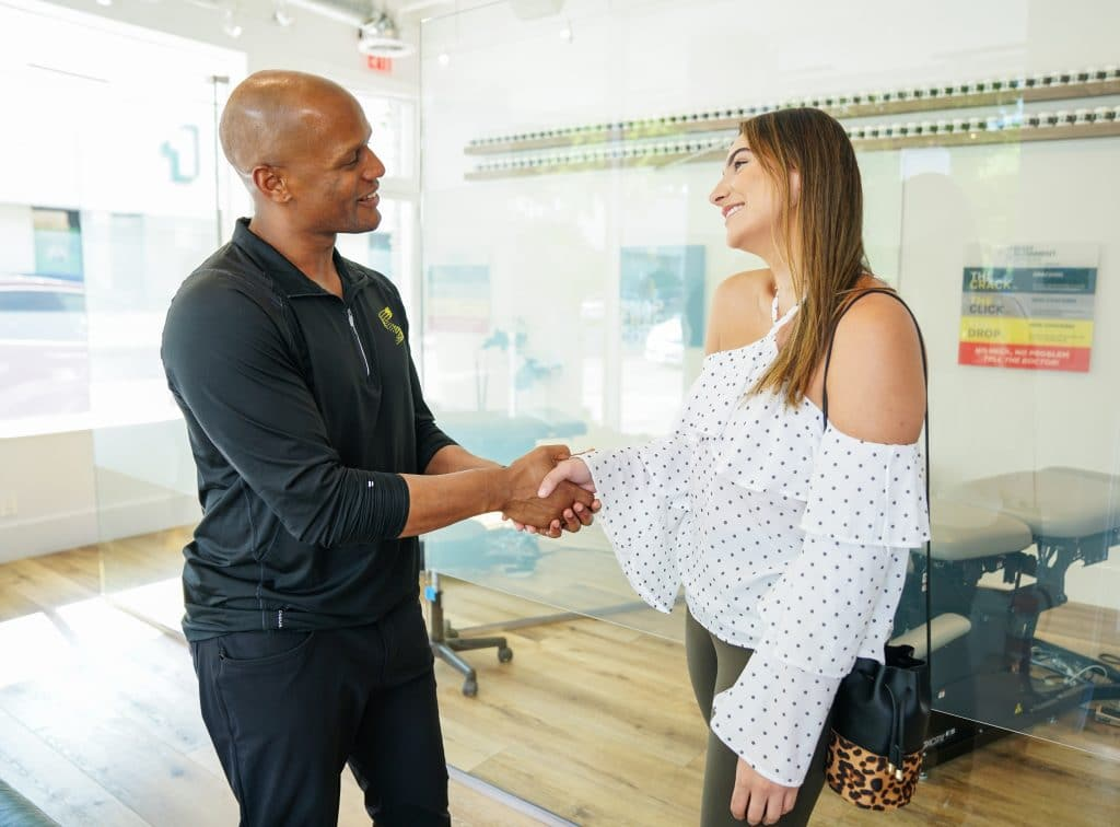 Chiropractor shaking a woman's hand