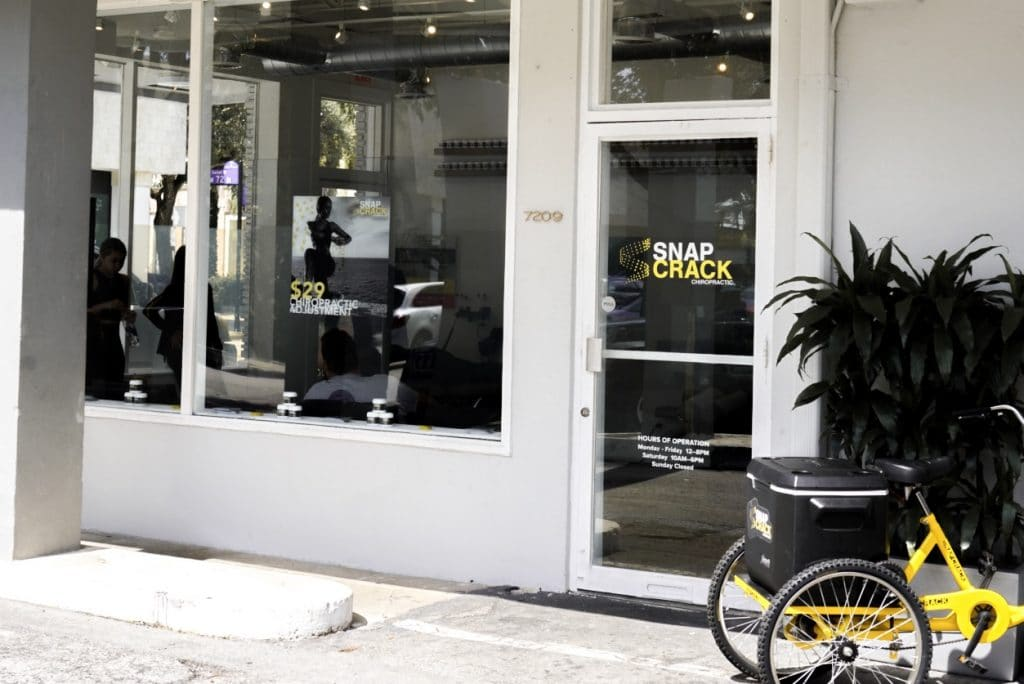 Snap Crack side entrance door with promotion tricycle parked in front
