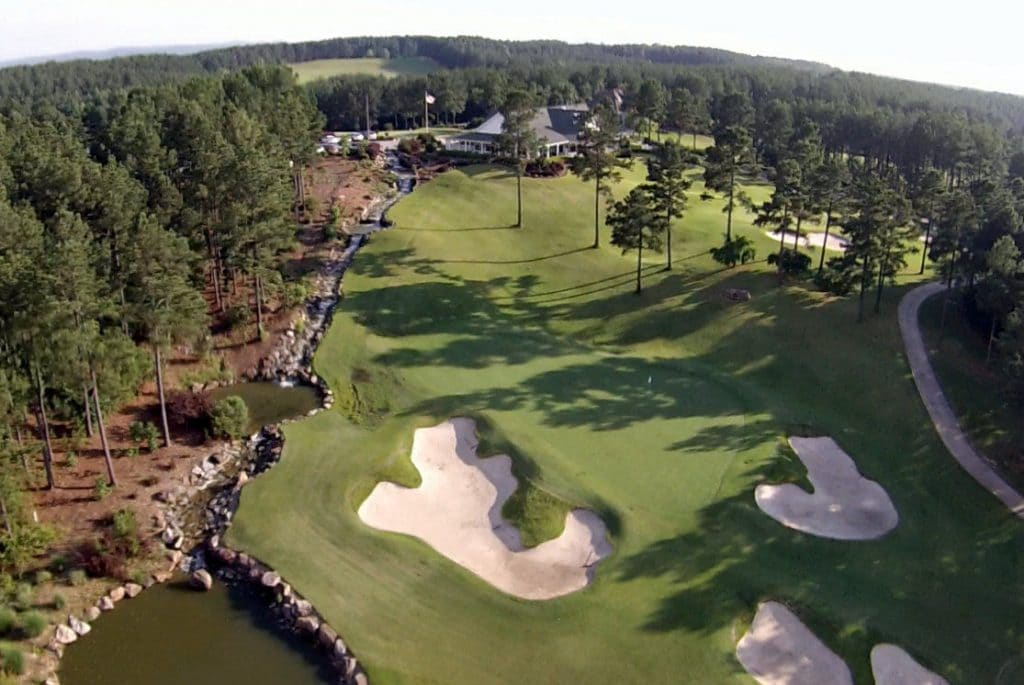aerial view of a golf course with sand bunkers